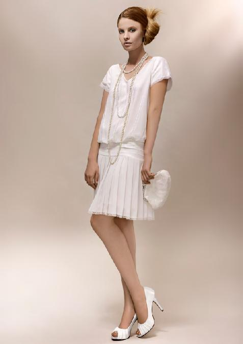 This 20s flipper style short wedding dress is designed by Max Chaoul ...